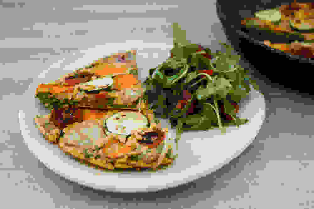 vegan lentil frittata and arugula side salad