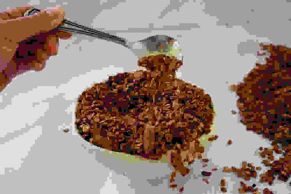 spreading coco pops granola