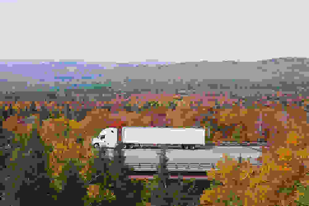 white truck on fall foliage background