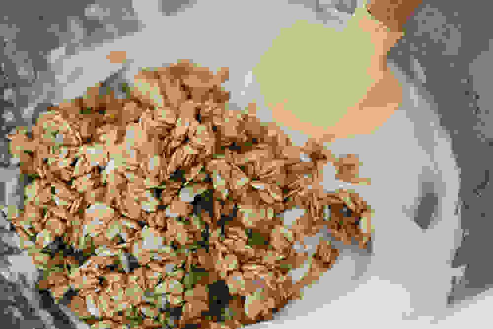 folding the whipped aquafaba into the oats mixture