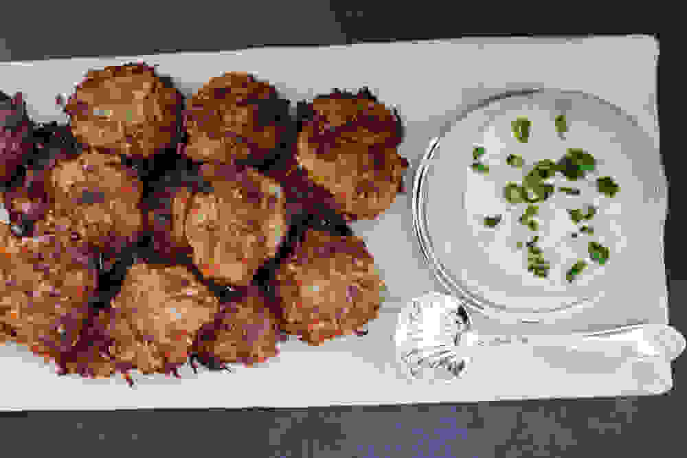 serving potato latkes with a vegan cheese mustard dip