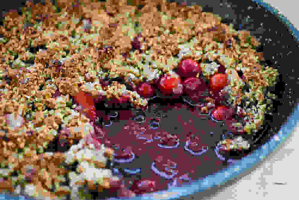 berry crumble with pistachio and almond fresh out of the oven