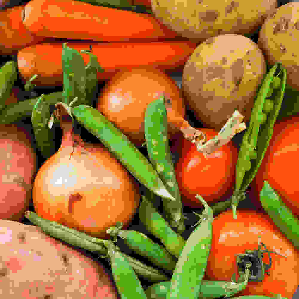 curry vegetables - potatoes, tomatoes, sweet potatoes, carrots, onions and peas