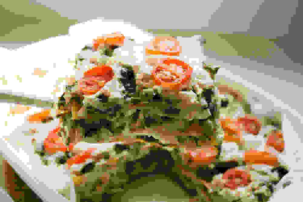 serving the vegan gluten-free chard and cashew lasagna