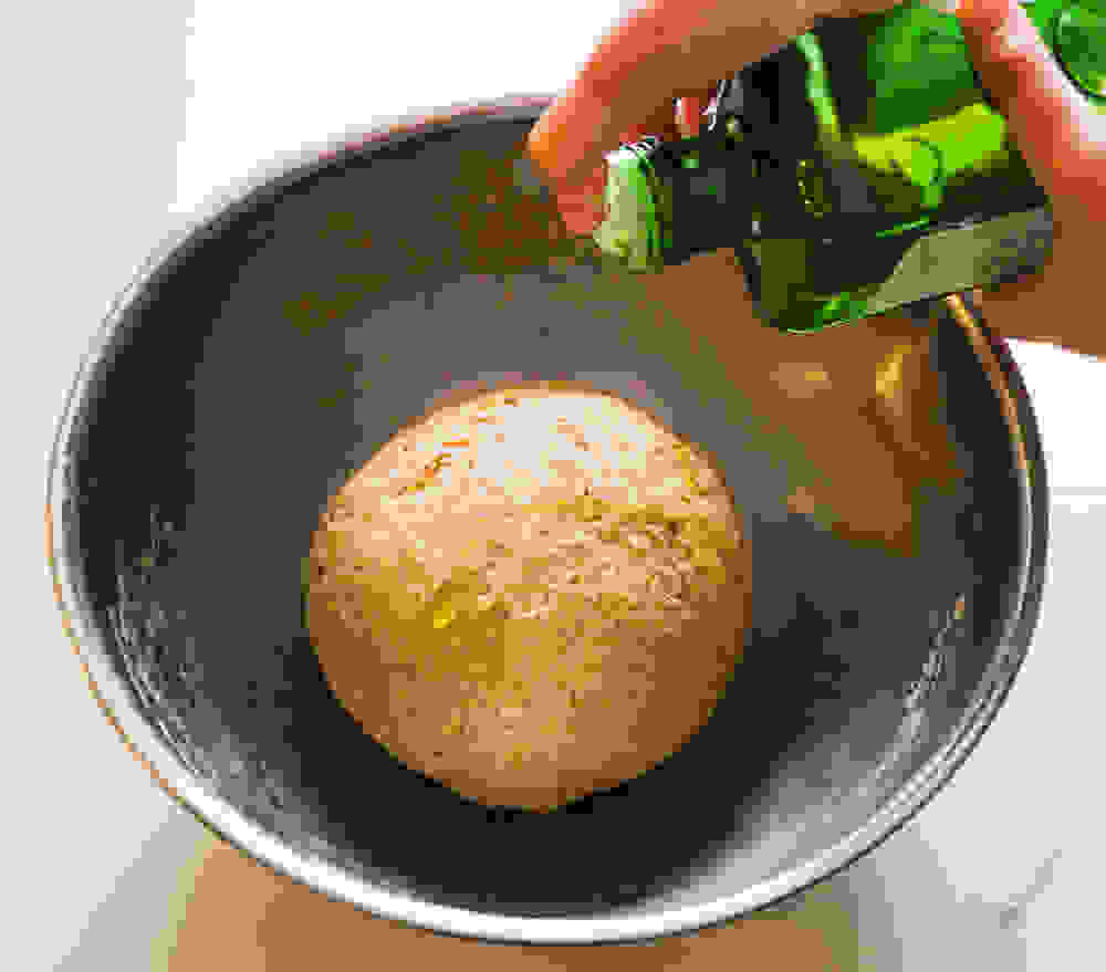 adding olive oil to the dough