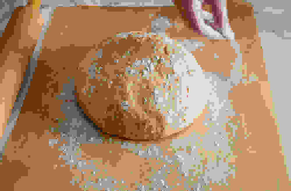 dusting flour over the raised dough