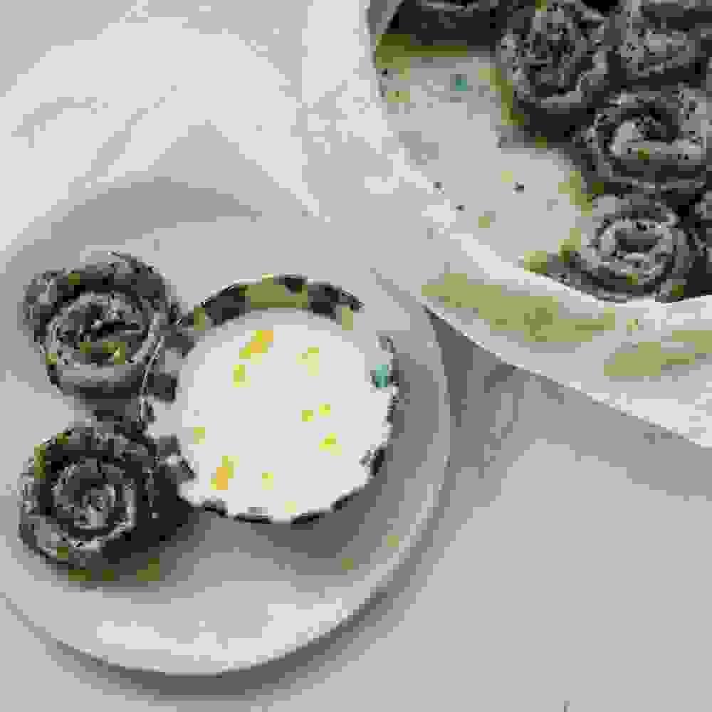 two gluten free vegan burrekas pastries next to a vegan yogurt dip