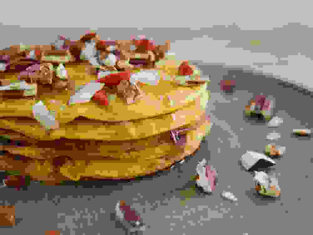 vegan pumpkin pancakes with pecans coconut goji berries and maple syrup