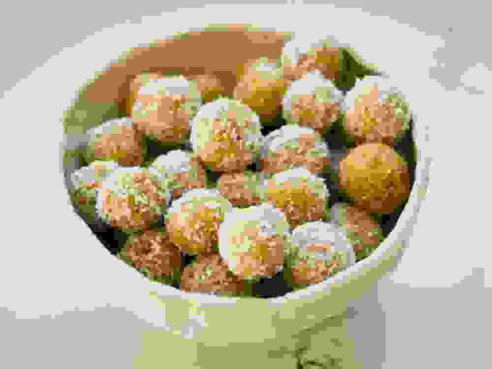 Mango Lime Coconut Protein Balls in a bowl