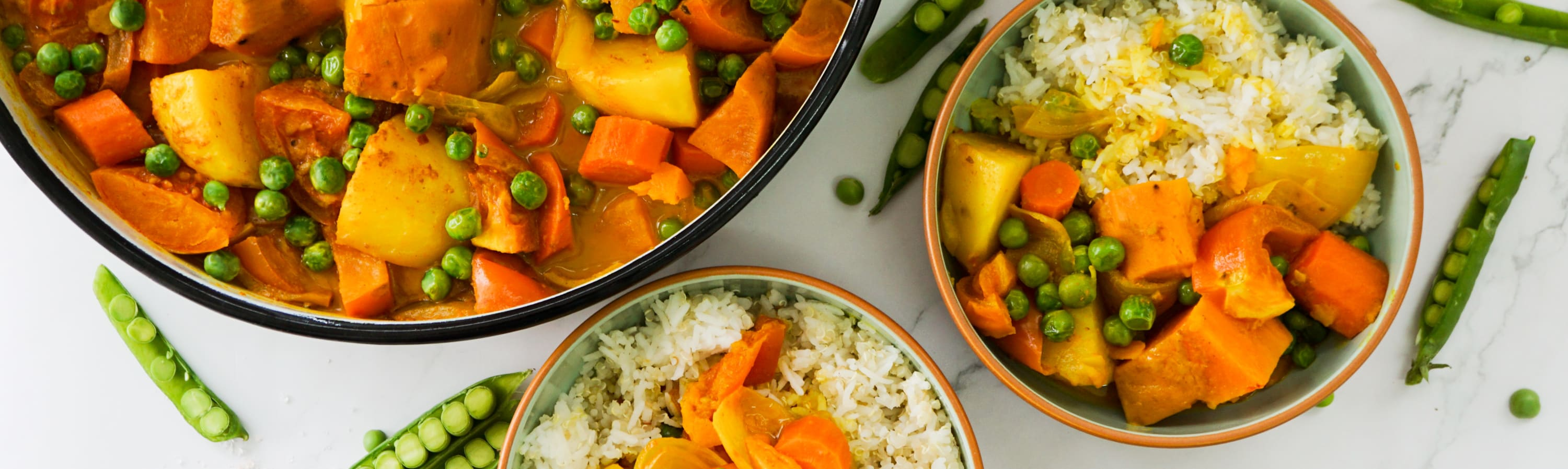 vegan yellow curry served with rice and quinoa