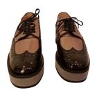 Chaussures à lacets  ROBERT CLERGERIE noir doré