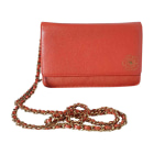 Sac pochette en cuir CHANEL Orange