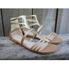 Sandales plates  BCBG MAX AZRIA Doré, bronze, cuivre
