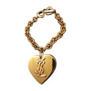 Bracelet YVES SAINT LAURENT Doré, bronze, cuivre