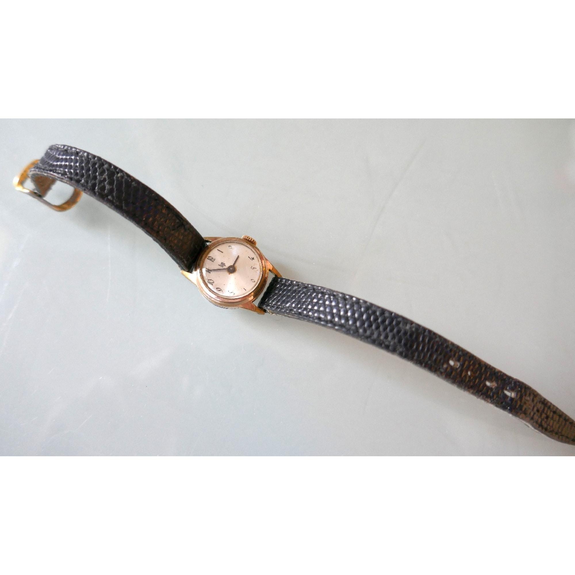 Montre au poignet LIP Doré, bronze, cuivre