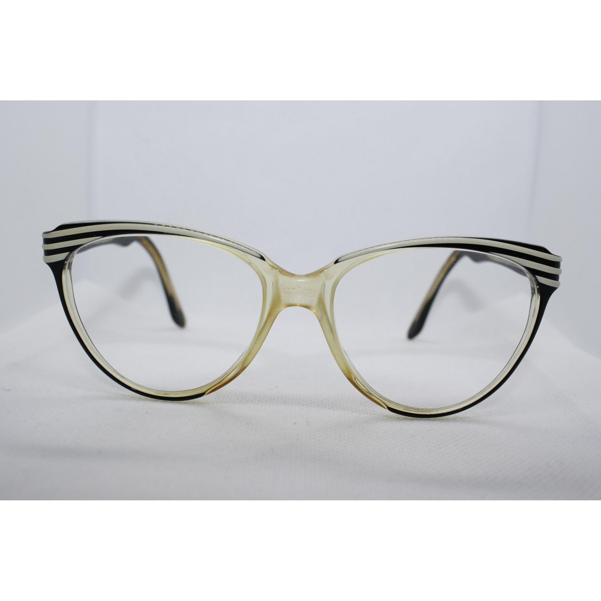 Monture de lunettes YVES SAINT LAURENT zebré de blanc sur noir sur transparence légèrement ambrées