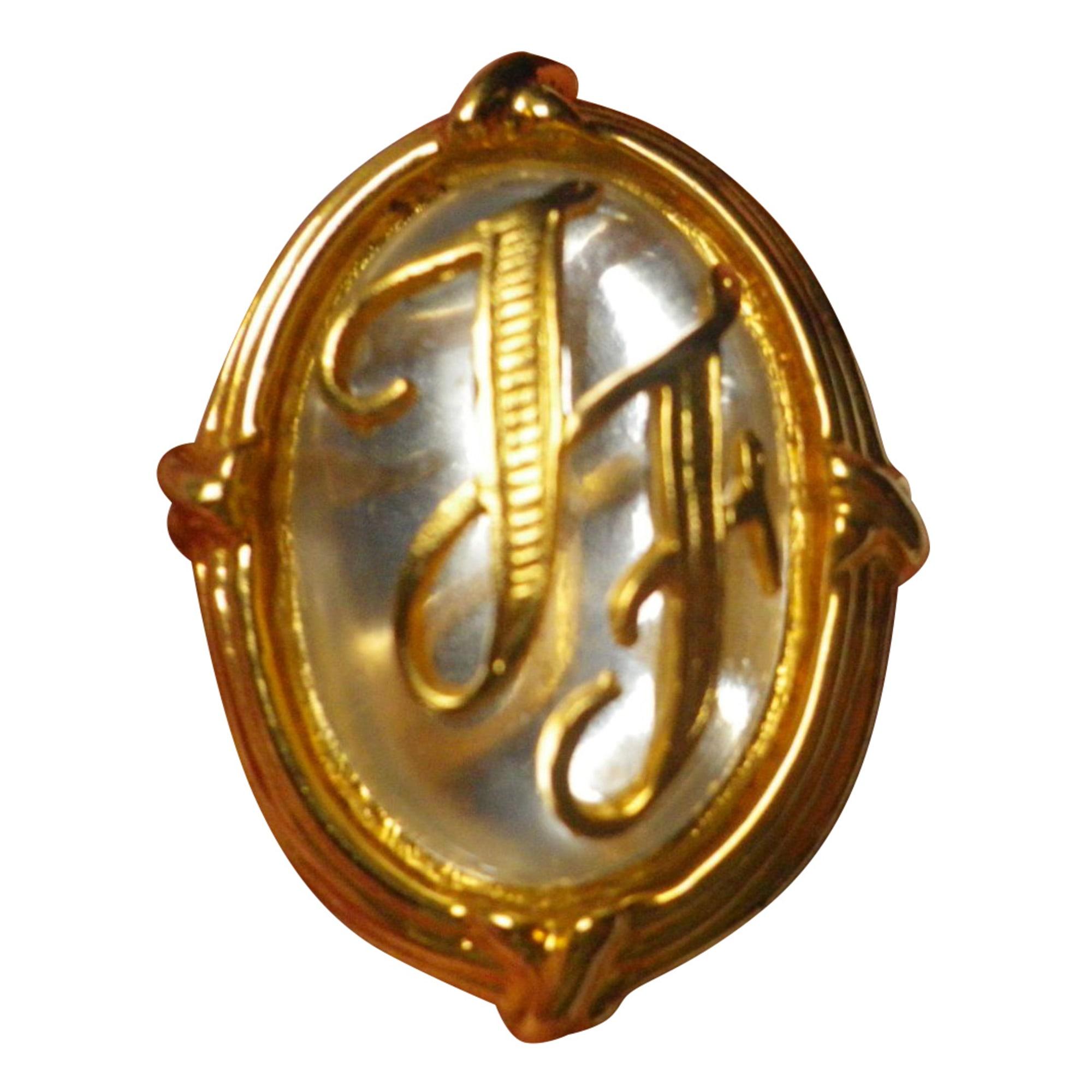 Broche INÈS DE LA FRESSANGE Doré, bronze, cuivre