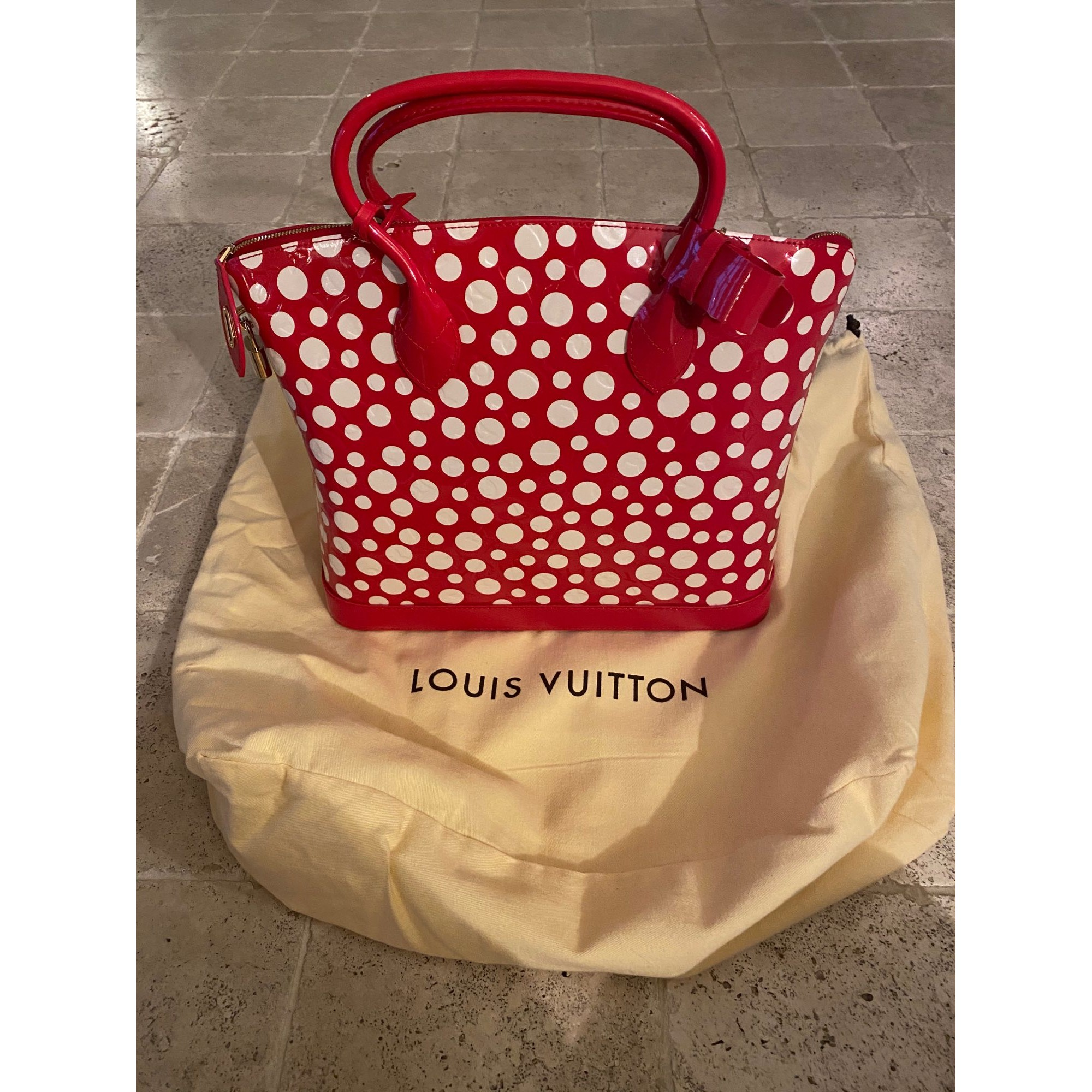 Sac à main en cuir LOUIS VUITTON Lockit Rouge, bordeaux
