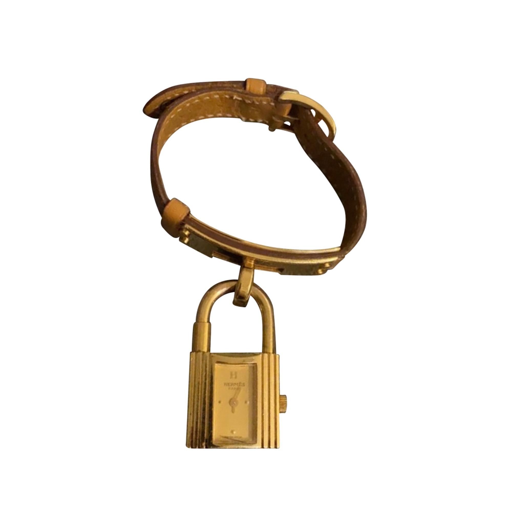 Montre au poignet HERMÈS Kelly Doré, bronze, cuivre