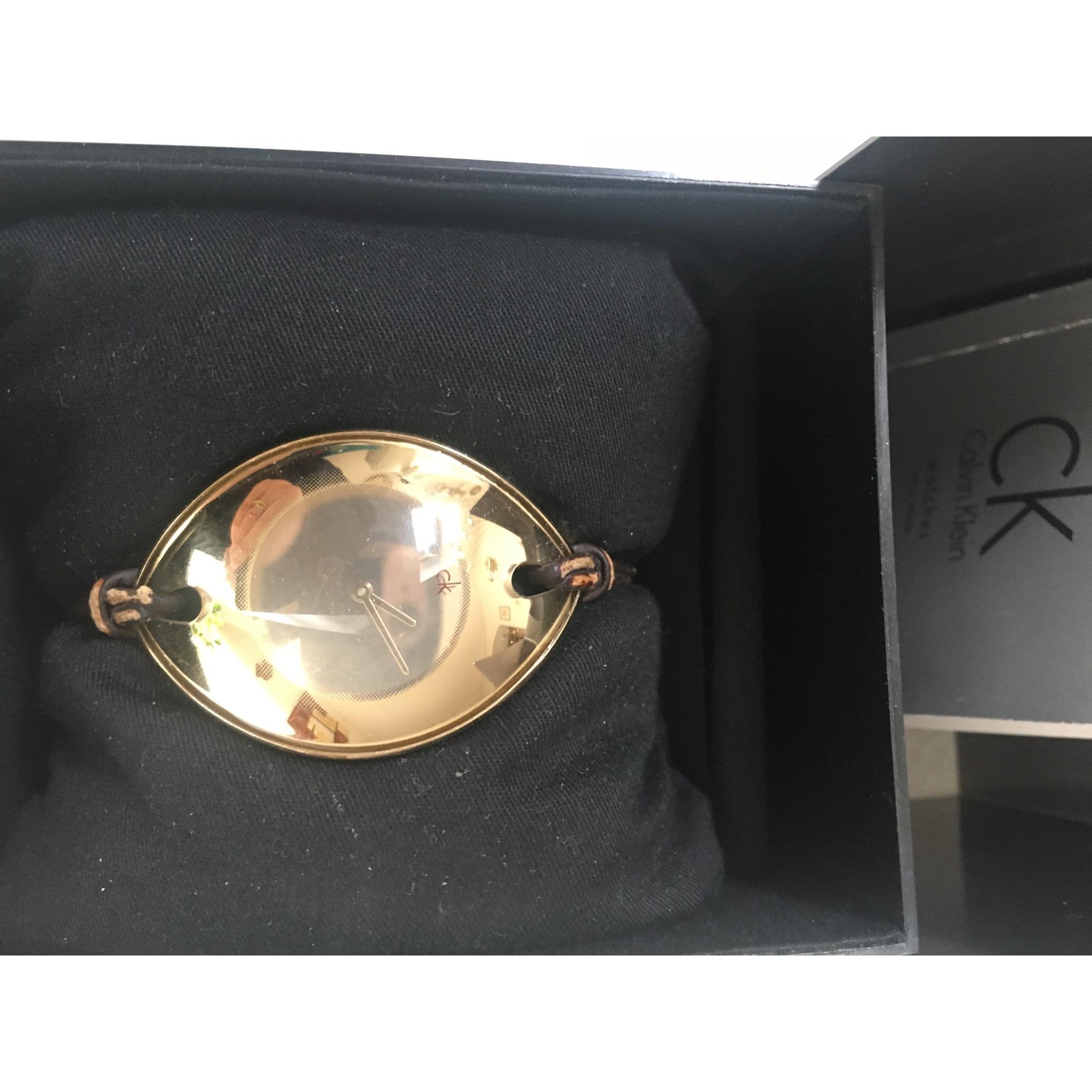 Montre au poignet CALVIN KLEIN Doré, bronze, cuivre