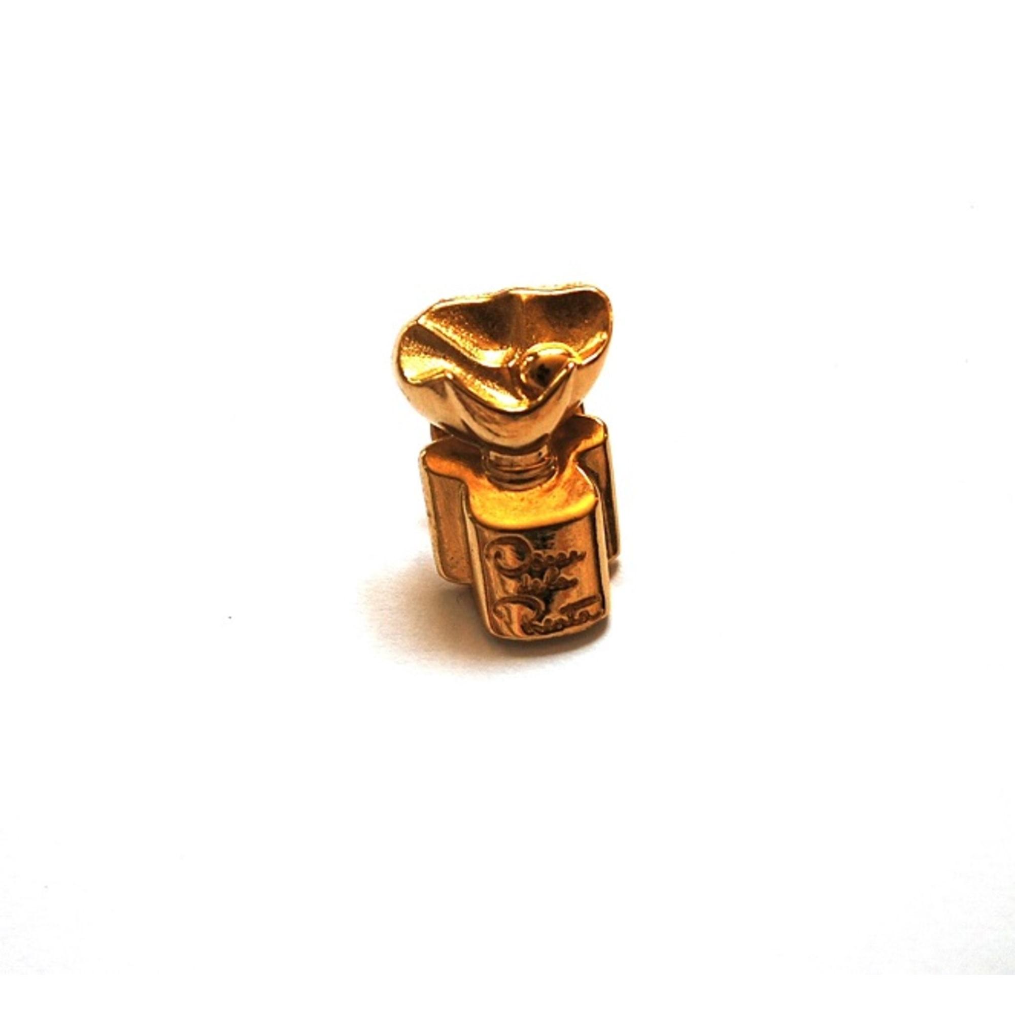 Pin's OSCAR DE LA RENTA Doré, bronze, cuivre