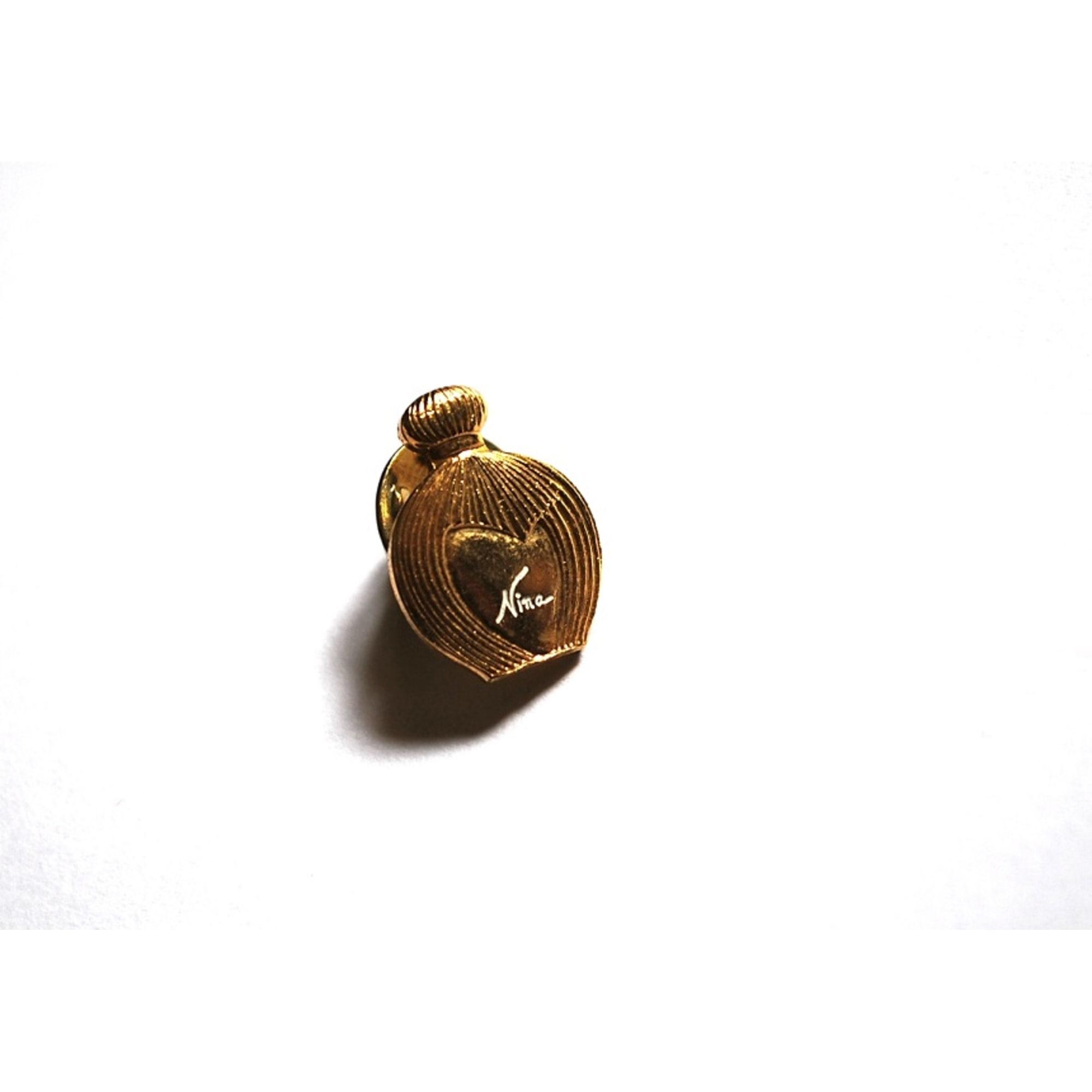 Pin's NINA RICCI Doré, bronze, cuivre