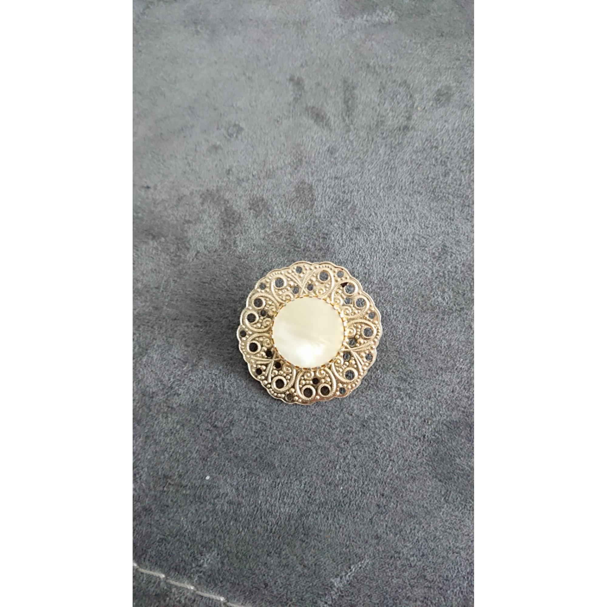 Broche MARQUE INCONNUE Doré, bronze, cuivre