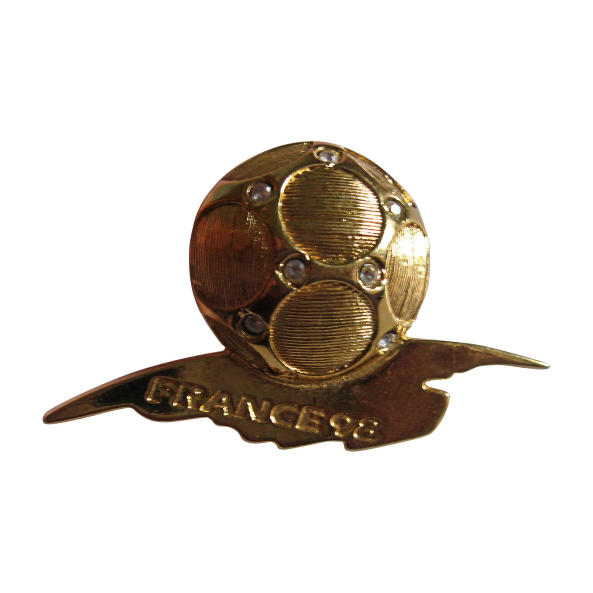 Broche YVES SAINT LAURENT Doré, bronze, cuivre