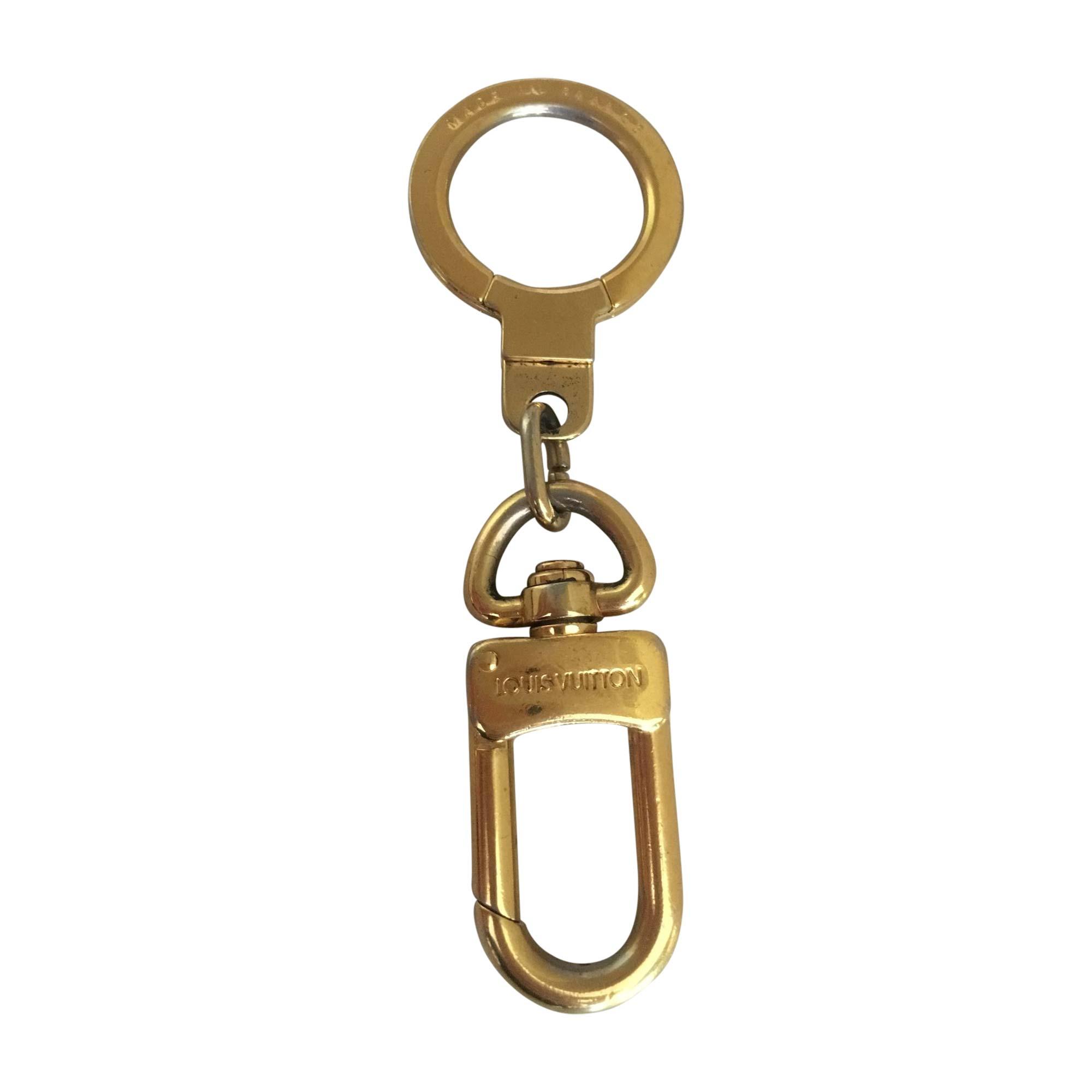 Porte-clés LOUIS VUITTON Doré, bronze, cuivre