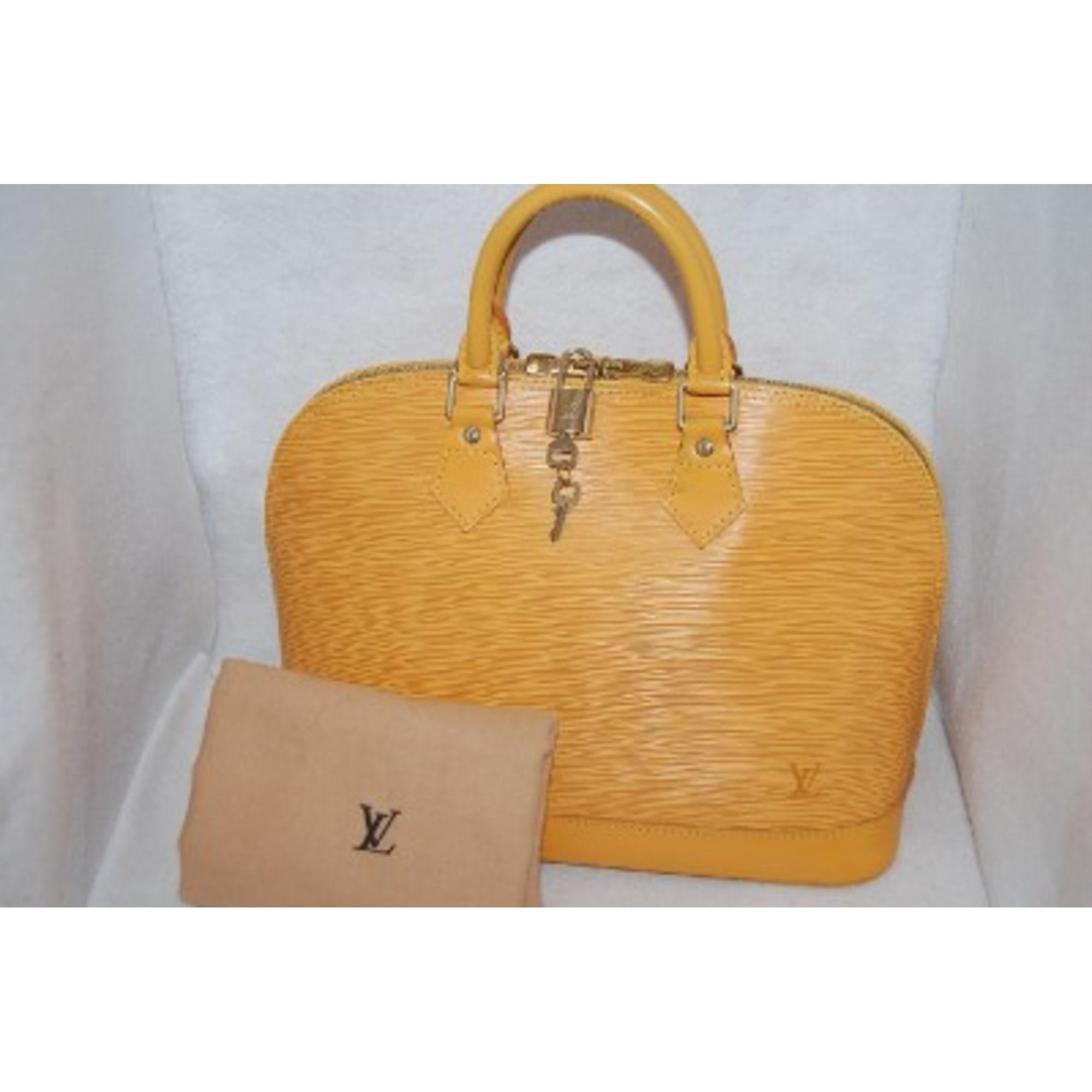 bdd7deaa08 Sac à main en cuir LOUIS VUITTON jaune vendu par La boutique de mode ...