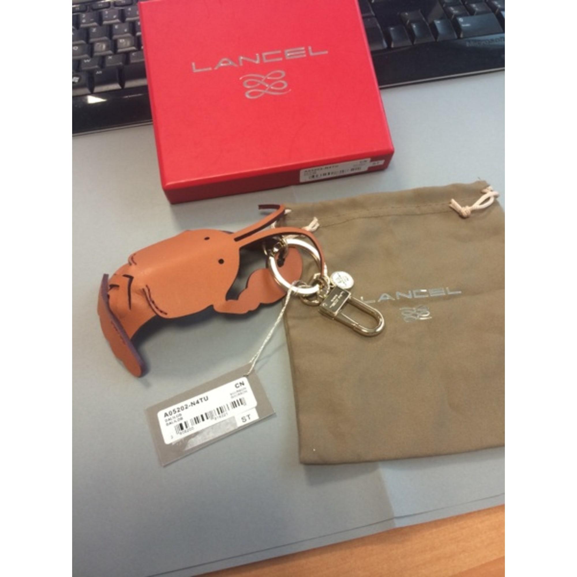 Porte-clés LANCEL beige vendu par Catycat 7154491 - 2603358 714c9241ea7