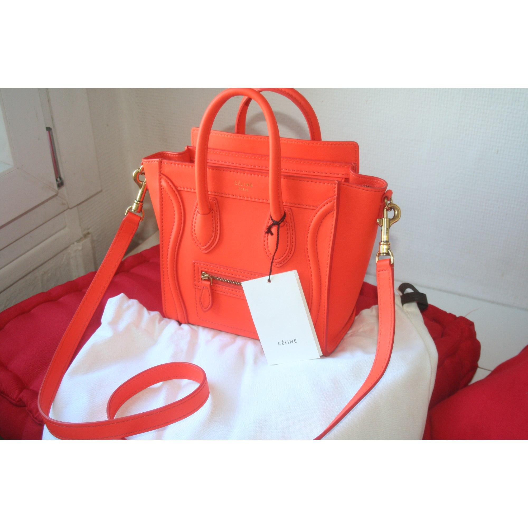 652c801c39 Sac en bandoulière en cuir CÉLINE nano luggage orange vendu par ...