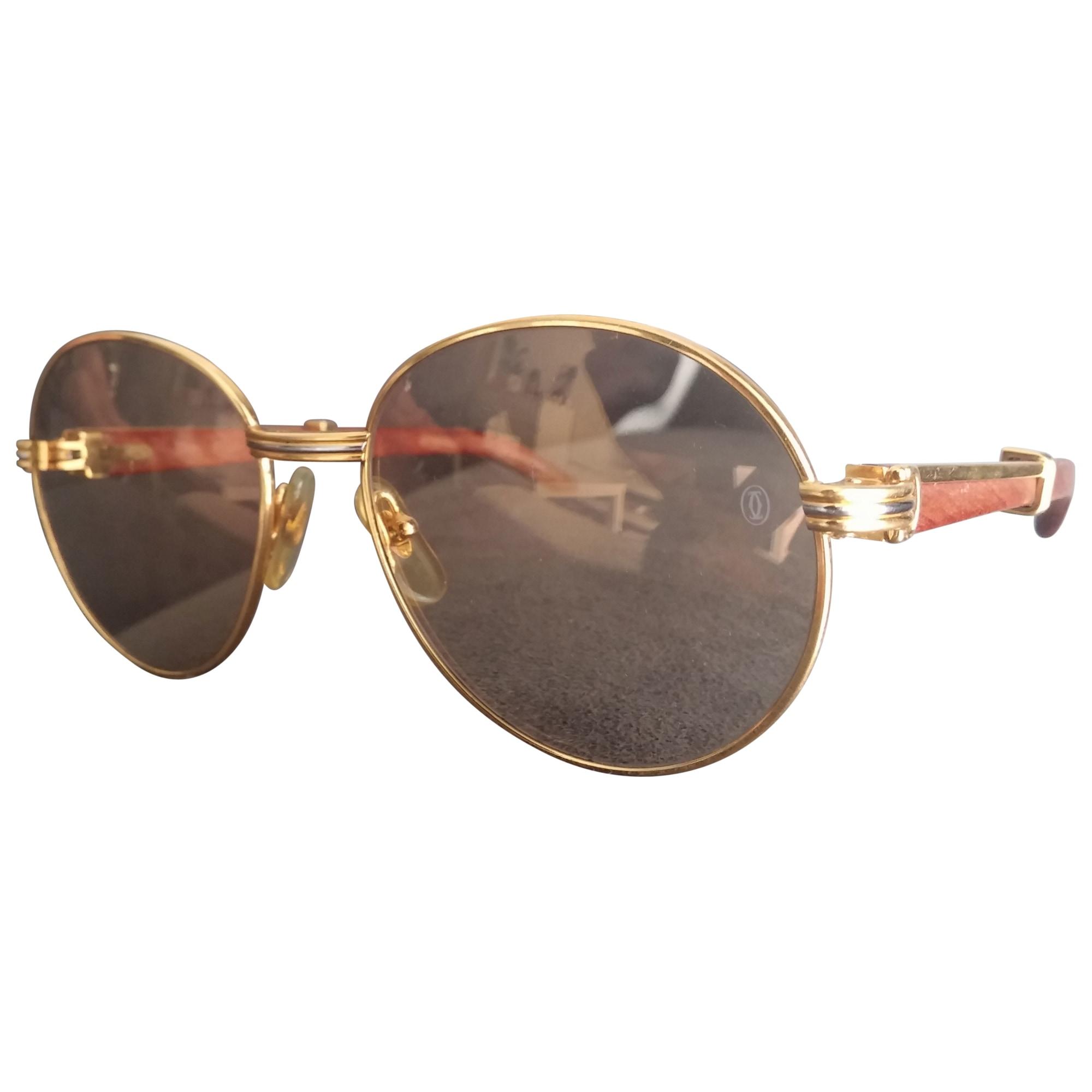 1b09e7891121cb Lunettes de soleil CARTIER Doré, bronze, cuivre