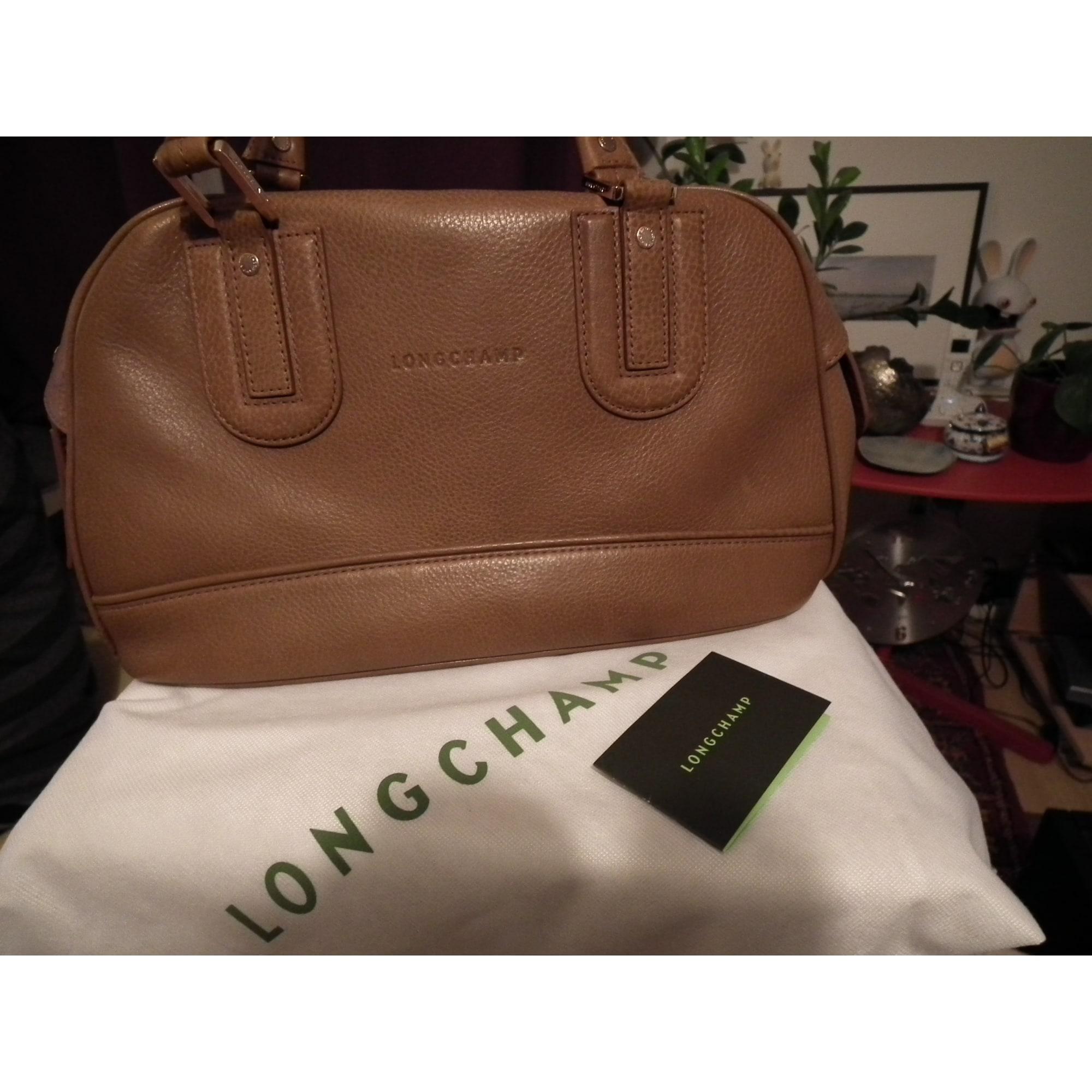 49f418a5a93c2 Sac à main en cuir LONGCHAMP beige vendu par Mary 945368 - 543537