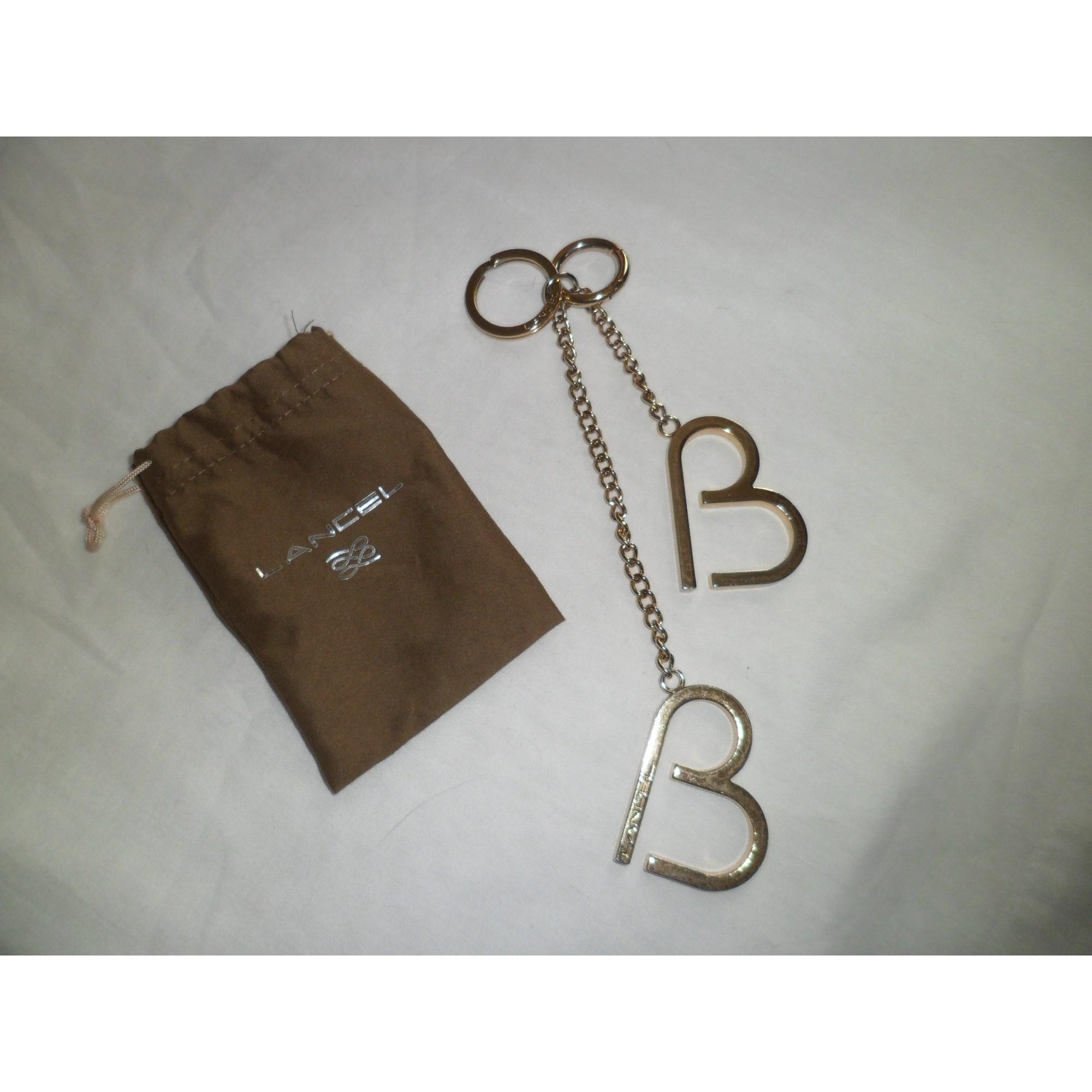 Porte-clés LANCEL brigitte bardot doré vendu par Dressing up  - 5460558 4b7fee5b2dc