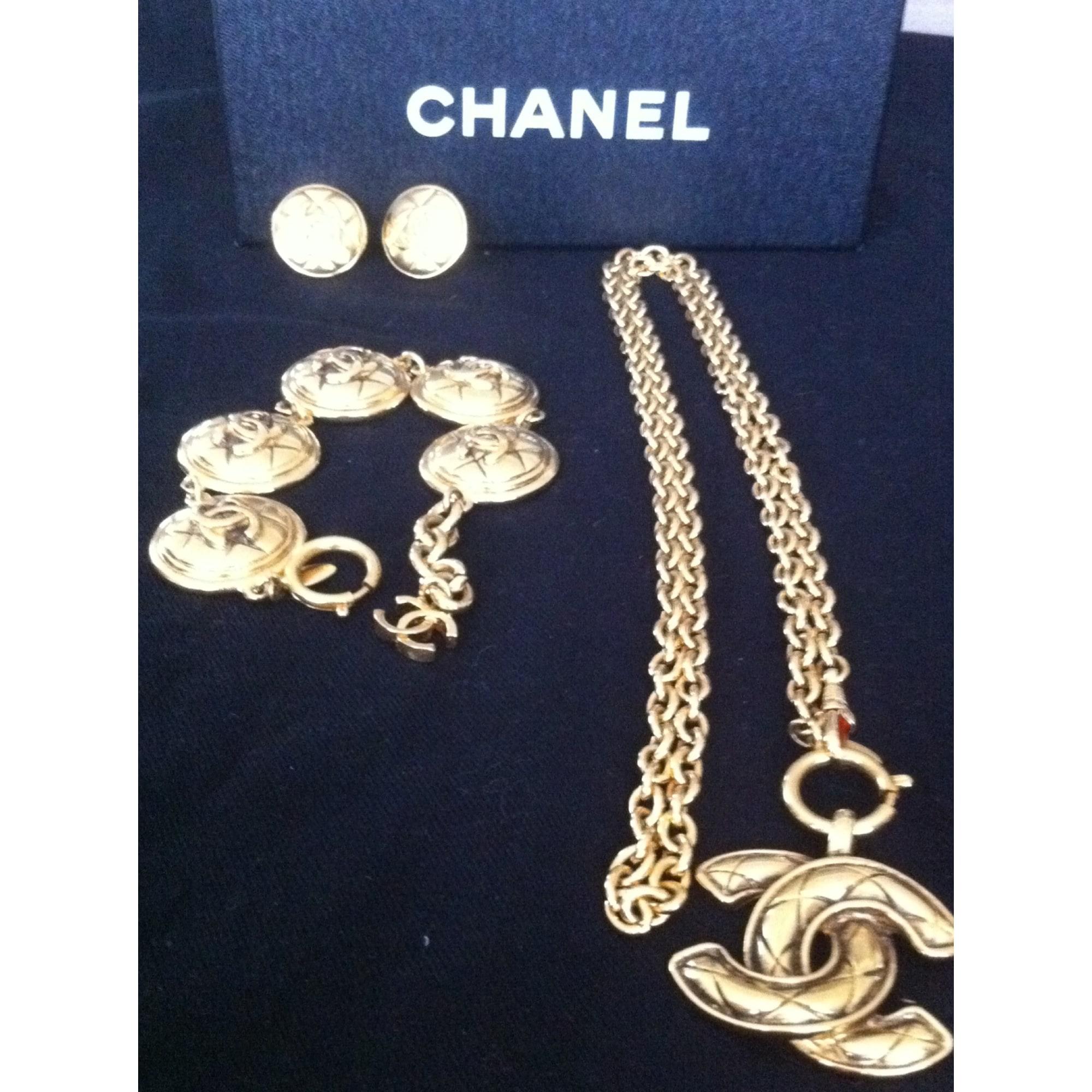 Parure bijoux CHANEL Doré, bronze, cuivre