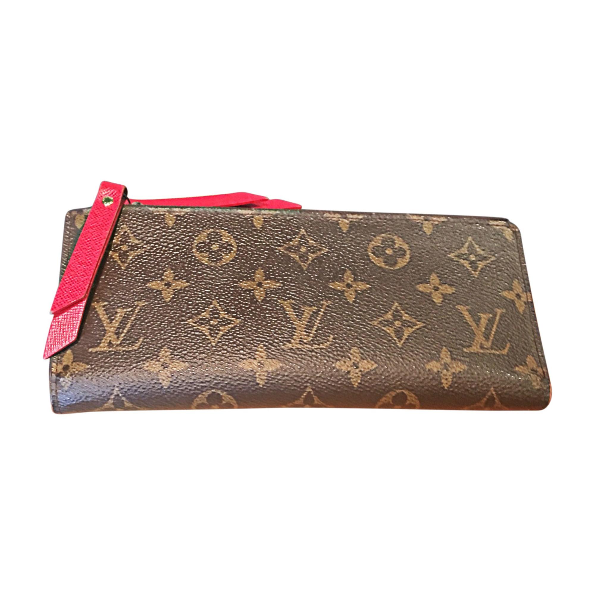 bfe395e66c92 Portefeuille LOUIS VUITTON monogram lv  rouge vendu par D ...