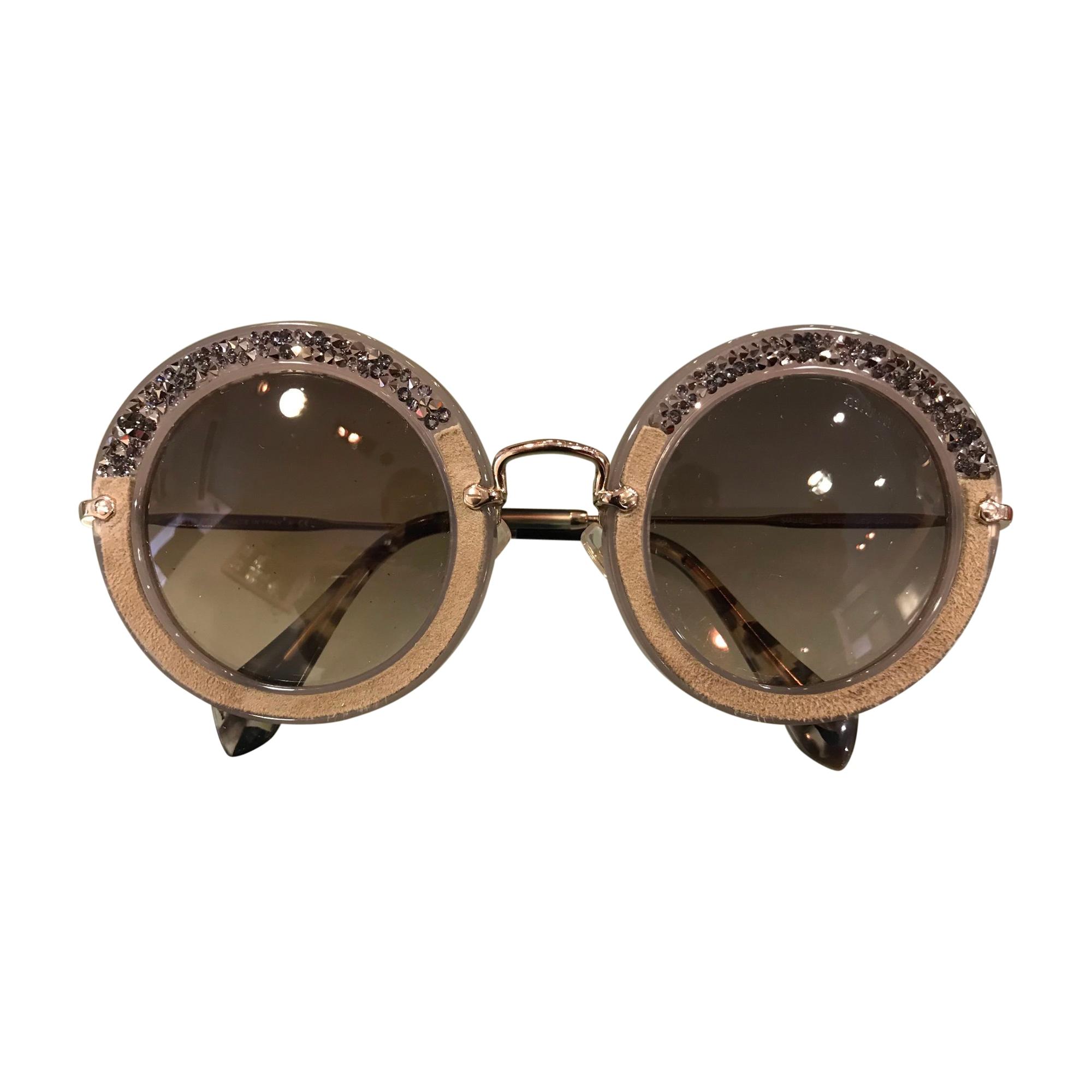 7d15f5ec45707f Lunettes de soleil MIU MIU gris vendu par Dress troc de haguenau ...