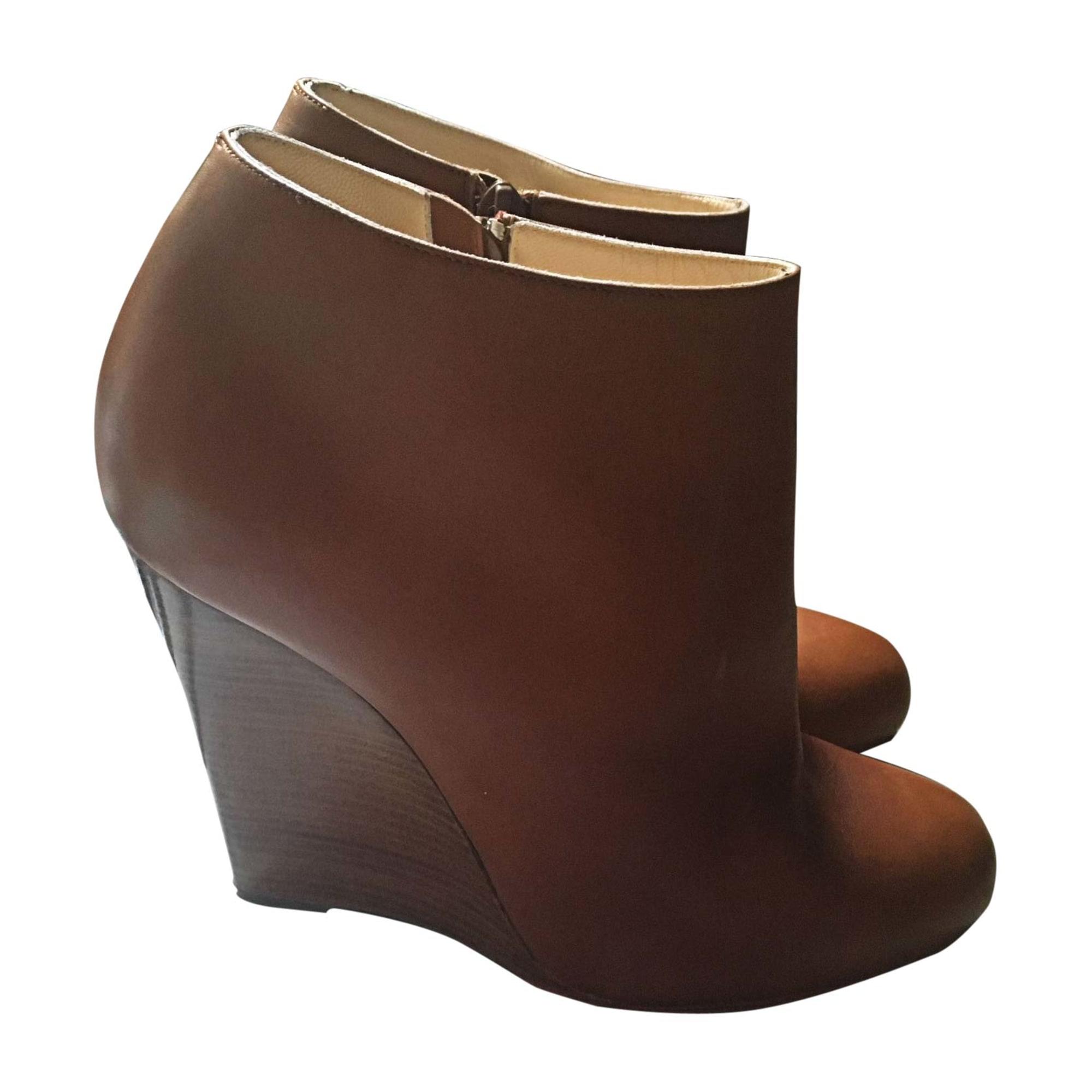 boots compensées louboutin