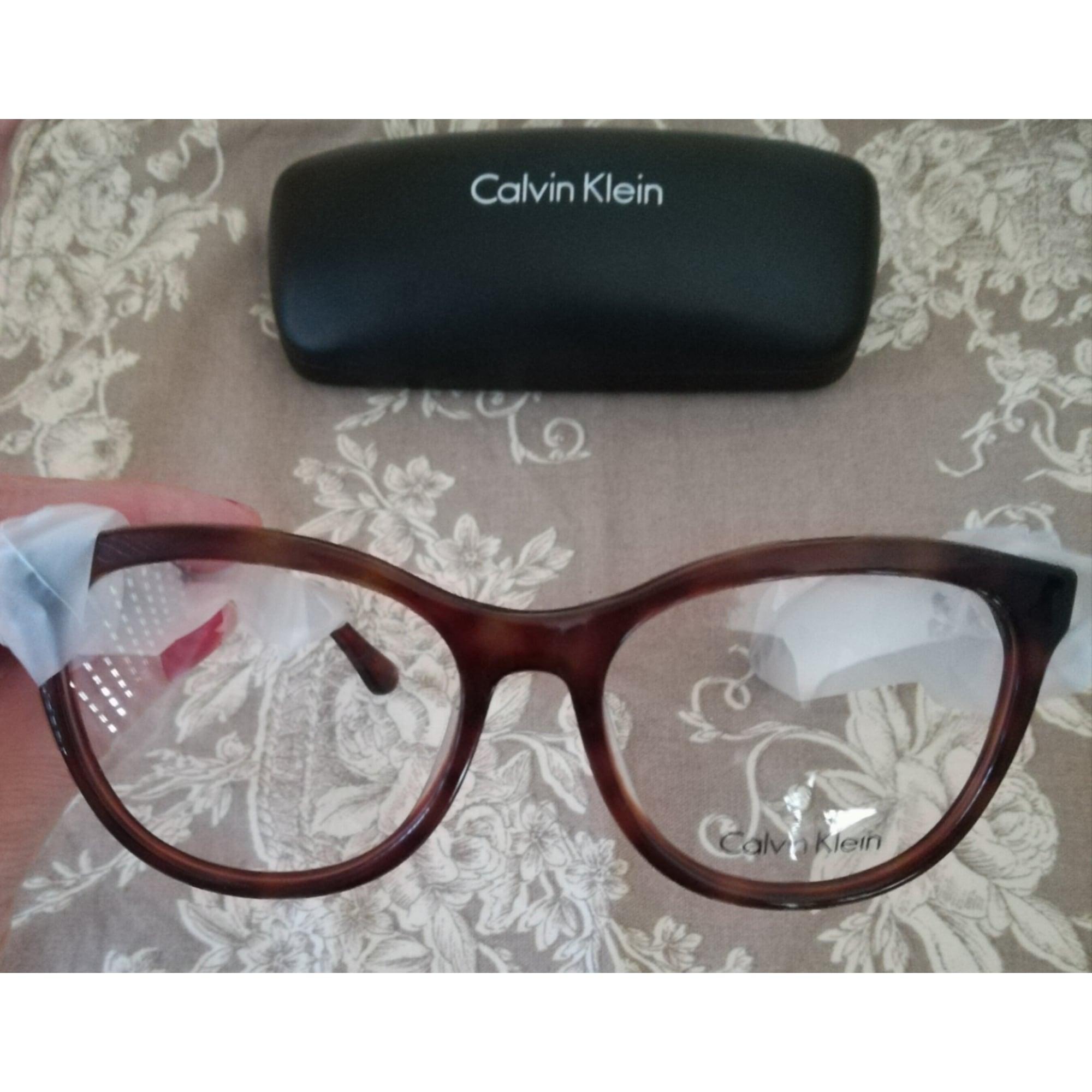 210c85cc16 Monture de lunettes CALVIN KLEIN marron vendu par Madylane62960 ...