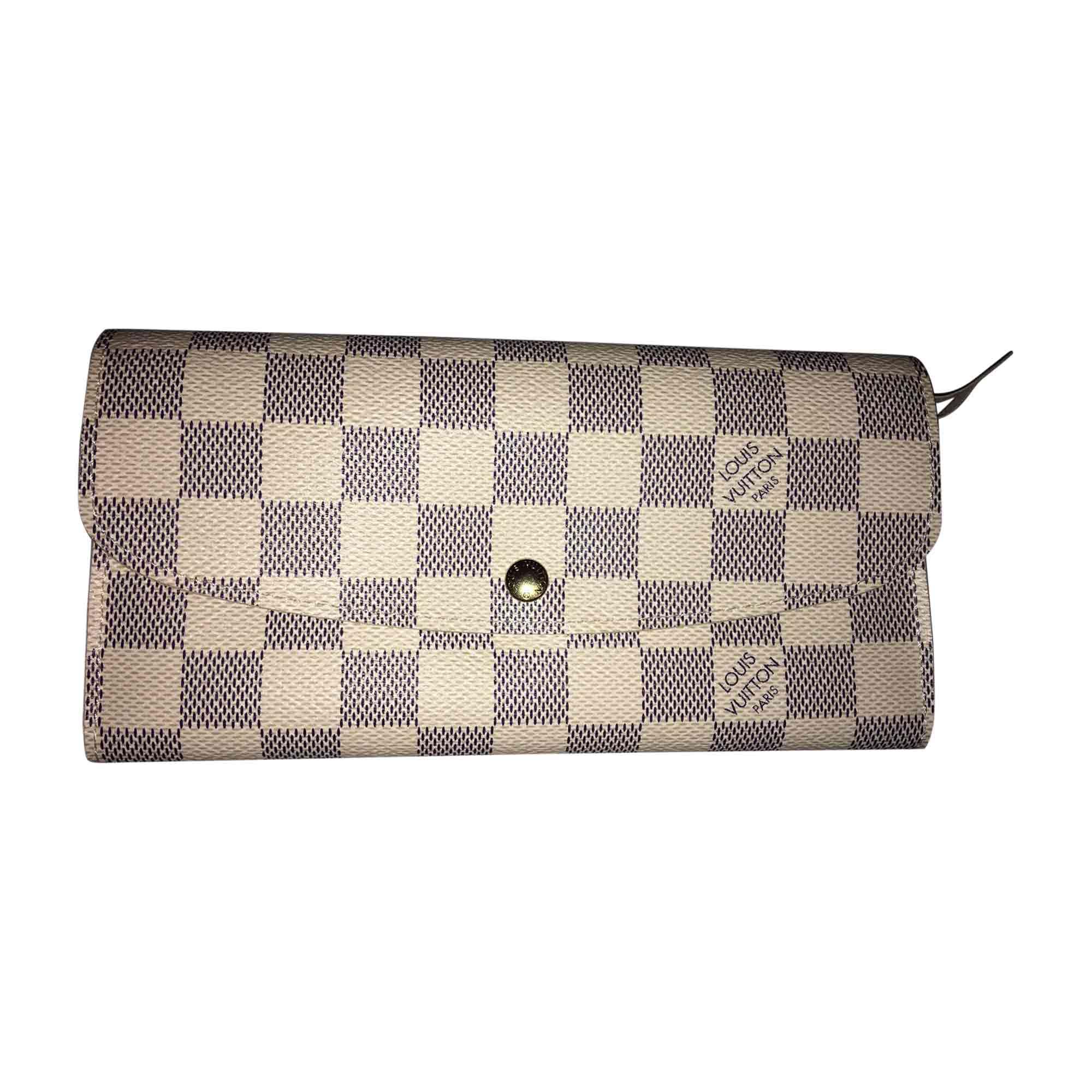 Portefeuille LOUIS VUITTON blanc vendu par Roxanne 07585829 - 8004378 0ace6725ce8