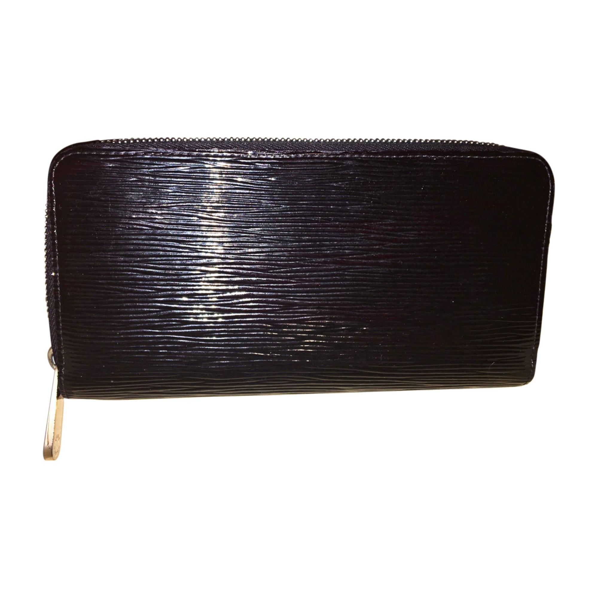 9da54f4e6a40 Portefeuille LOUIS VUITTON noir vendu par Roxanne 07585829 - 8074472