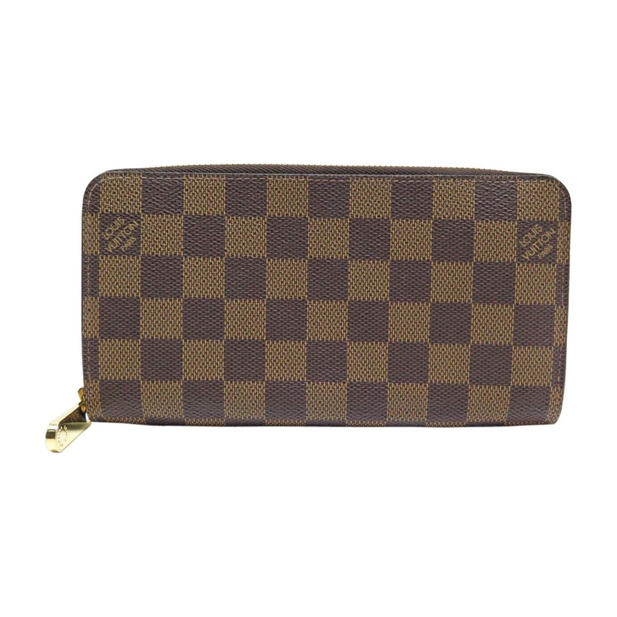Portefeuille LOUIS VUITTON zippy marron vendu par Encherexpert ... 63e2db2f152