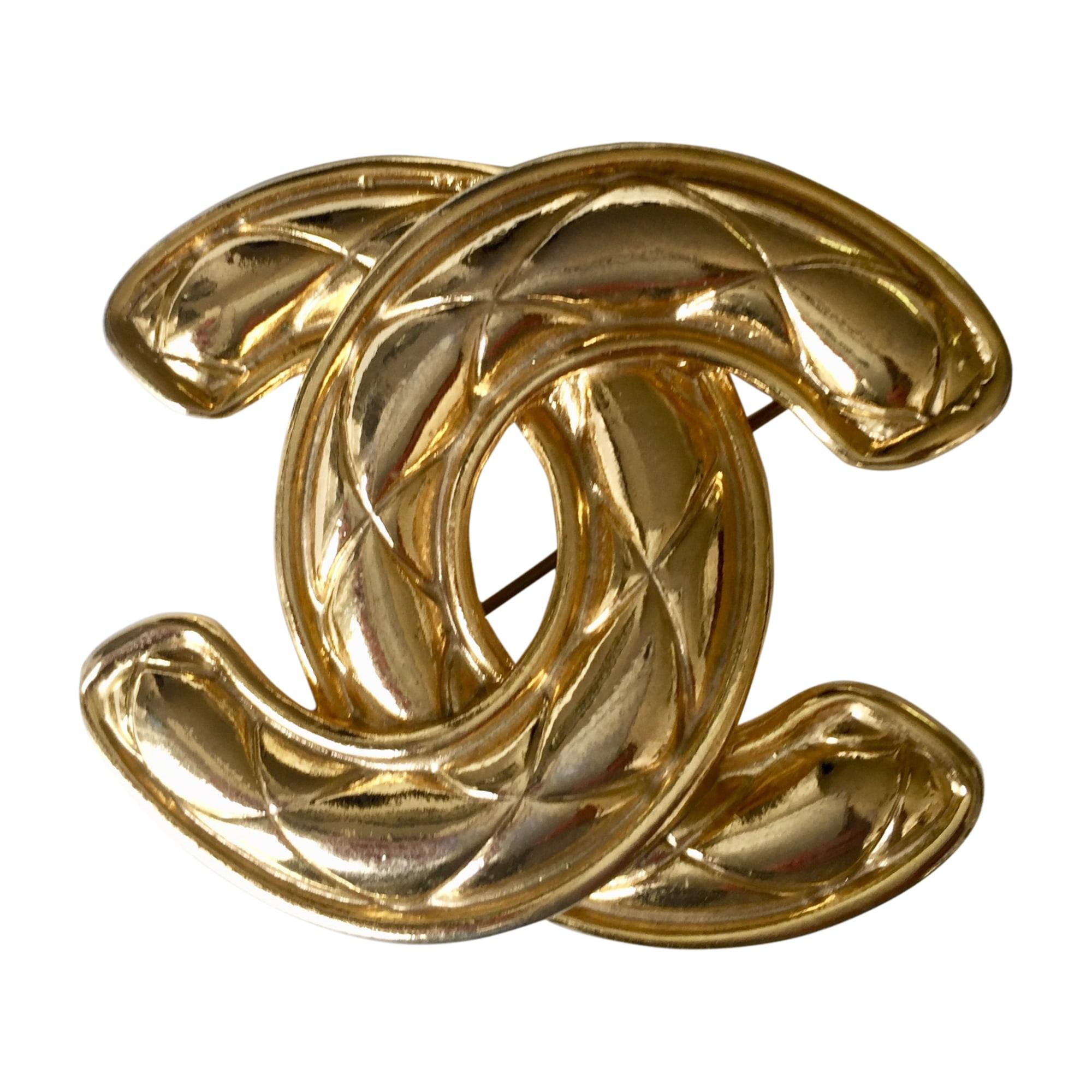Broche CHANEL Doré, bronze, cuivre