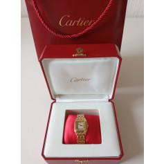 Montre au poignet Cartier  pas cher