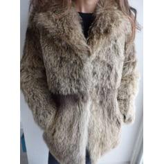 Manteau en fourrure tanneur  pas cher