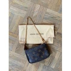 Sac à main en cuir Louis Vuitton Pochette Accessoires NM pas cher