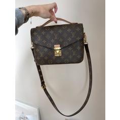 Sac pochette en cuir Louis Vuitton Metis pas cher