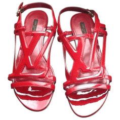 Sandales plates  LOUIS VUITTON Rouge, bordeaux