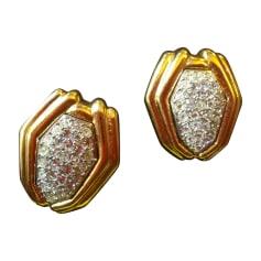 Boucles d'oreilles YVES SAINT LAURENT Doré, bronze, cuivre